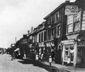 "A 1914 image showing the ""Palace Theatre"" sign above the High Street passage far right."